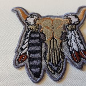 Ecusson crane buffle plume petit